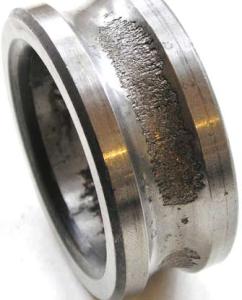 Местное выкрашивание внутреннего кольца шарикоподшипника при вращающейся радиальной силе, неподвижном наружном кольце и одновременном воздействии осевой силы