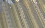 Пластические сдвиги на рабочей поверхности зубчатой передачи - напряжения на площадках контактов превысили предел текучести (начальная стадия)