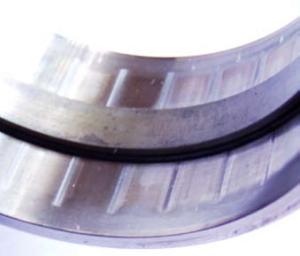 Местное изнашивание беговой дорожки наружного кольца двухрядного радиального роликоподшипника при колебательном движении