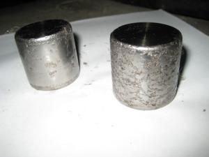 Следы осповидного износа на поверхности опорных роликов